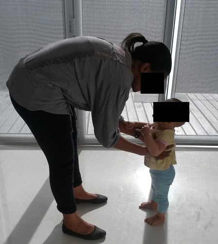 poor child lifting technique, lower back pain, lack of lumbar lordosis